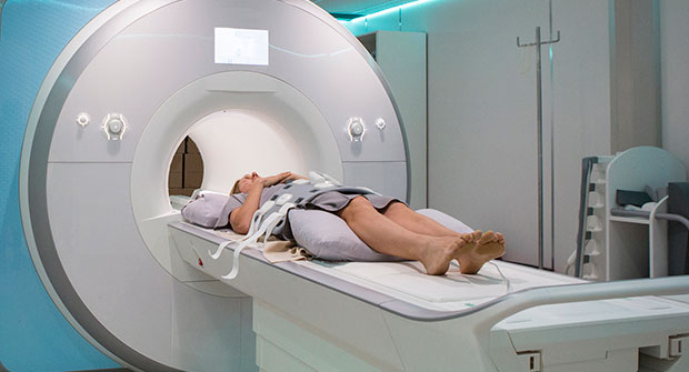 Woman in CT Machine